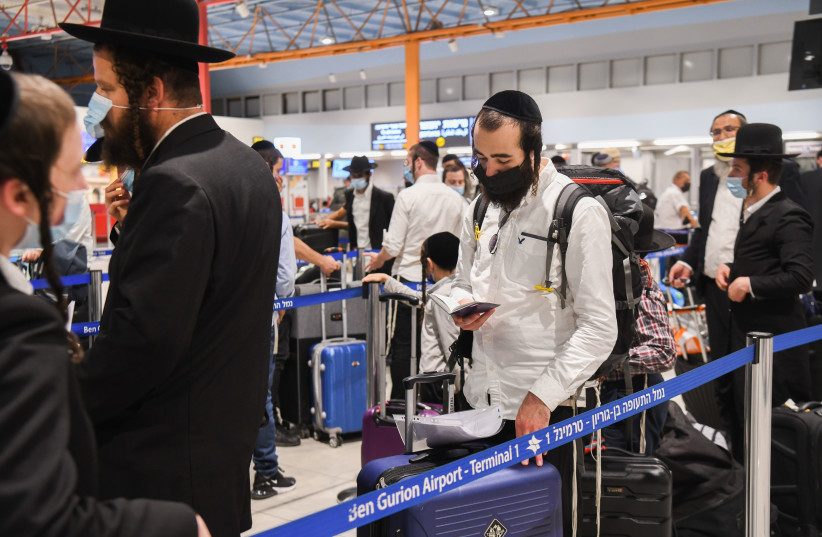 Ultra orthodox Jewish men make there way to Uman for the Jewish holiday of Rosh Hashanah at the ben gurion international airport near Tel Aviv on September 1, 2021.  (credit: YOSSI ZELIGER/FLASH90)