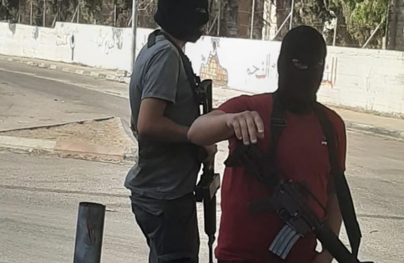 masked gunmen in the streets of Jenin Refugee Camp (credit: KHALED ABU-TOAMEH)
