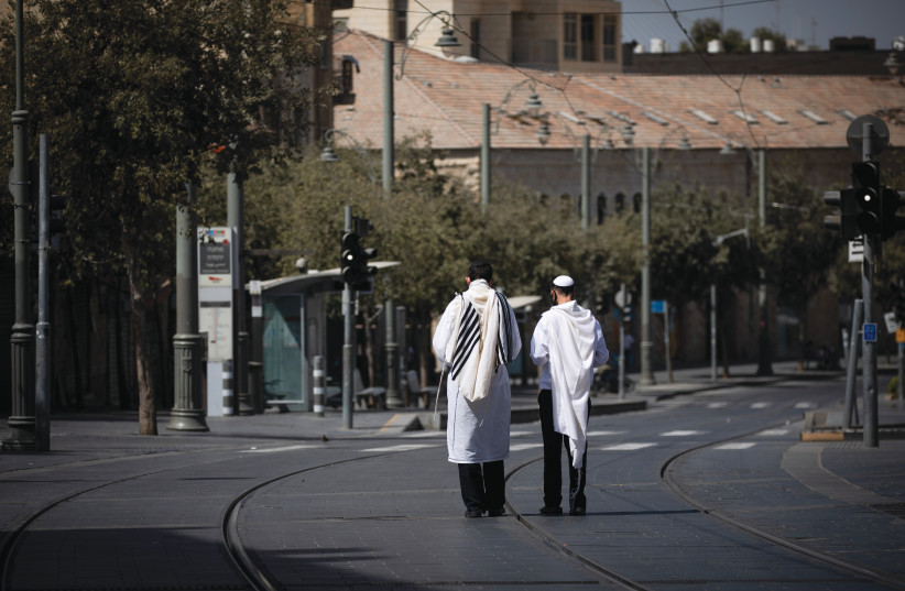 ABSOLUTE QUIET: Walking the  empty streets on Yom Kippur.  (credit: YONATAN SINDEL/FLASH90)
