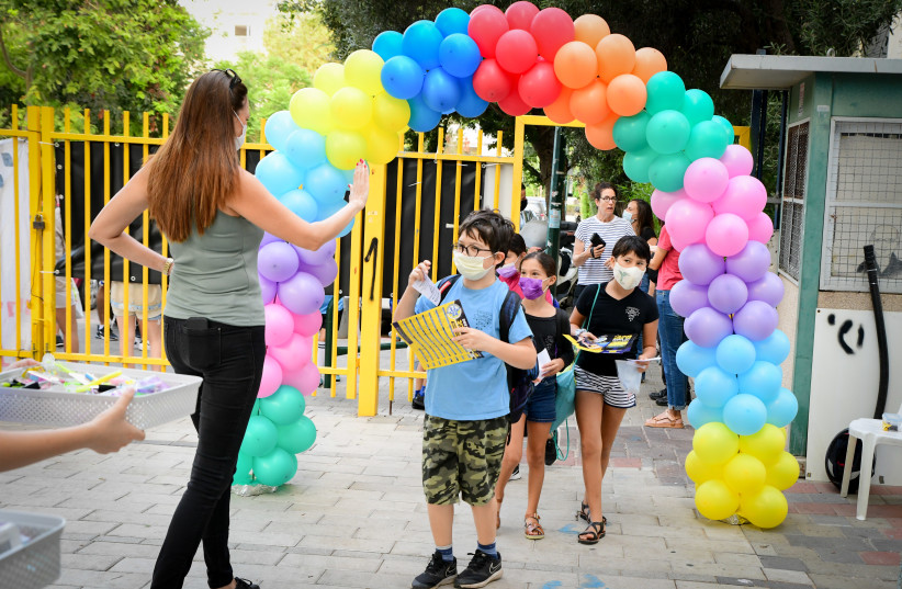 51. We have a great educational  system. Pictured: Arriving on the  first day of school, Sept. 1.   (credit: AVSHALOM SASSONI/FLASH90)