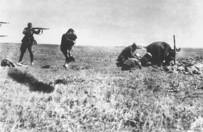 Executions of Jews by German army mobile killing units (Einsatzgruppen) near Ivangorod Ukraine. (credit: Wikimedia Commons)