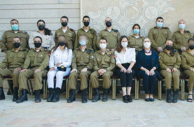 MICHAL HERZOG and Yael Kohavi with IDF soldiers. (credit: IDF SPOKESMAN'S OFFICE)