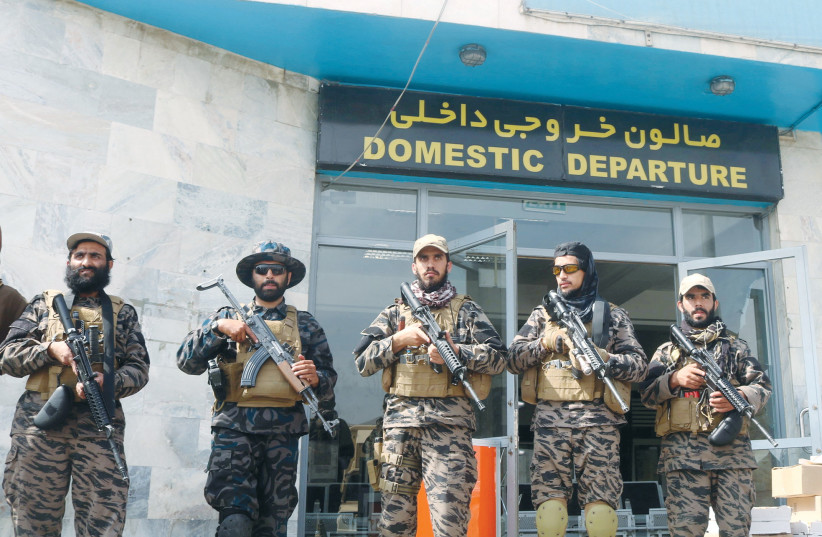 TALIBAN FORCES stand guard a day after the US troops withdrawal from Hamid Karzai International Airport in Kabul, Afghanistan, last month. (credit: REUTERS)