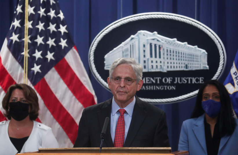 U.S. Attorney General Merrick Garland, accompanied by Deputy Attorney General Lisa Monaco and Associate Attorney General Vanita Gupta, announces a civil lawsuit to sue Texas over its abortion law, during a news conference at the Justice Department in Washington, D.C., U.S., September 9, 2021. (credit: REUTERS/LEAH MILLIS)
