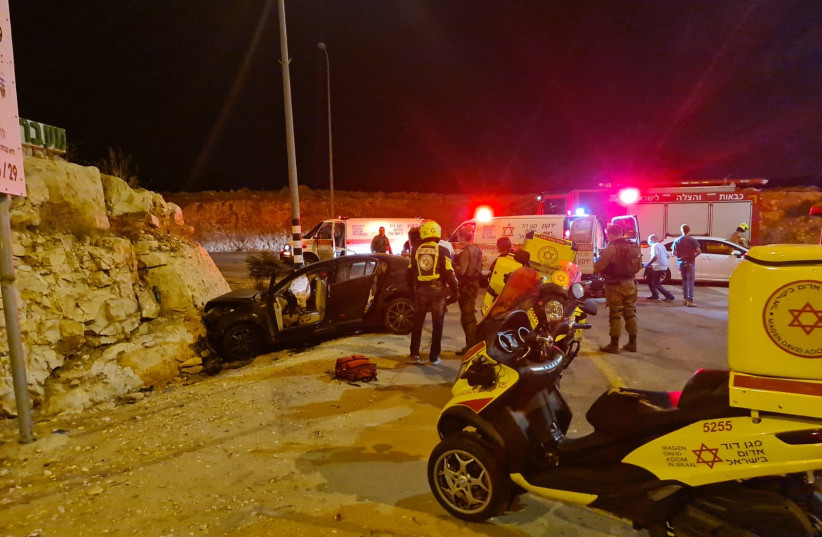 The crashed car in the incident near Eliyahu checkpoint on Highway 55 on September 12, 2021. (photo credit: MAGEN DAVID ADOM)