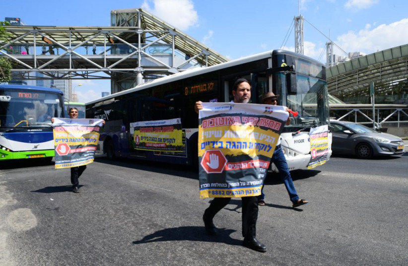 Bus drivers march in Tel Aviv in protest of the violent attacks against them. (credit: AVSHALOM SASSONI)