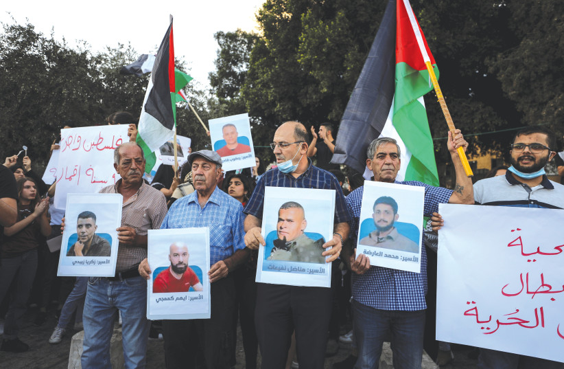 A RALLY IN Nazareth over the weekend in support of the six Palestinian convicts who had escaped from prison. (photo credit: REUTERS/AMMAR AWAD)
