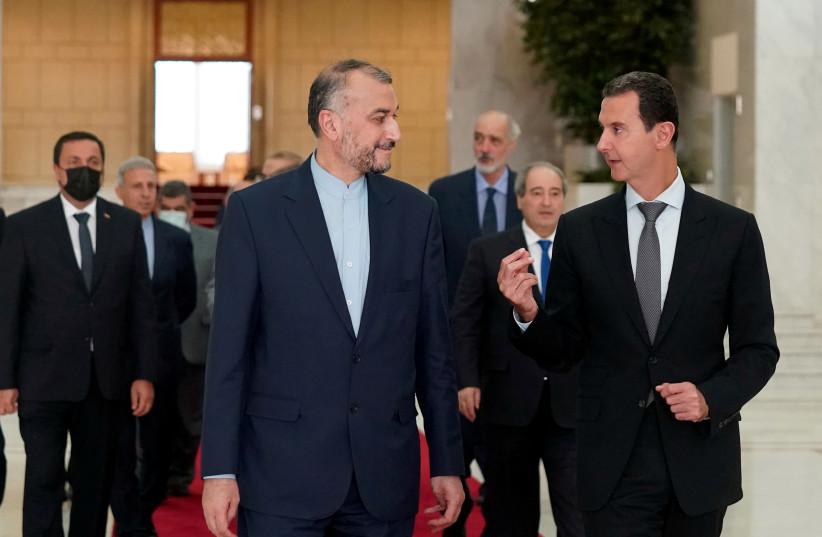 SYRIAN PRESIDENT Bashar Assad (right) meets with Iranian Foreign Minister Hossein Amir-Abdollahian in Damascus, August 29. (photo credit: SANA/HANDOUT VIA REUTERS)