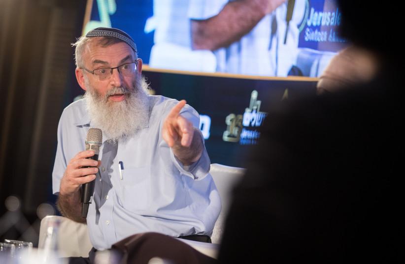 Chairman of Tzohar organization Rabbi David Stav speaks at the 16th annual Jerusalem Conference of the 'Besheva' group, on February 12, 2019 (credit: HADAS PARUSH/FLASH90)