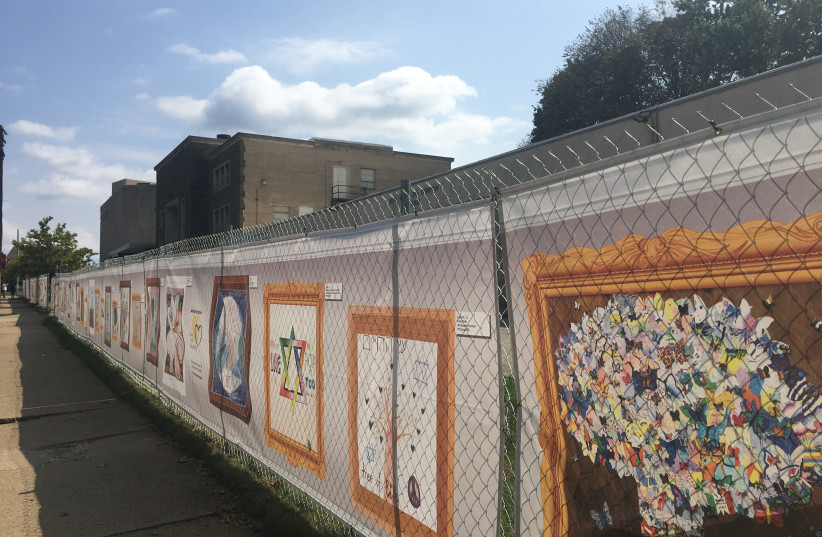 The #HeartsTogether art project, an artistic response by the community in the wake of the shooting, line the fence of the synagogue. (Be (credit: BETH KISSILEF)