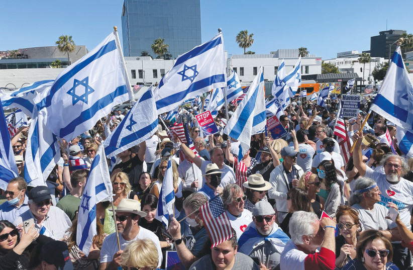 Pro-Israel advocates gather in Los Angeles at an IAC-organized rally in May which was part of the organization's nationwide campaign supporting Israel.  (photo credit: IAC)