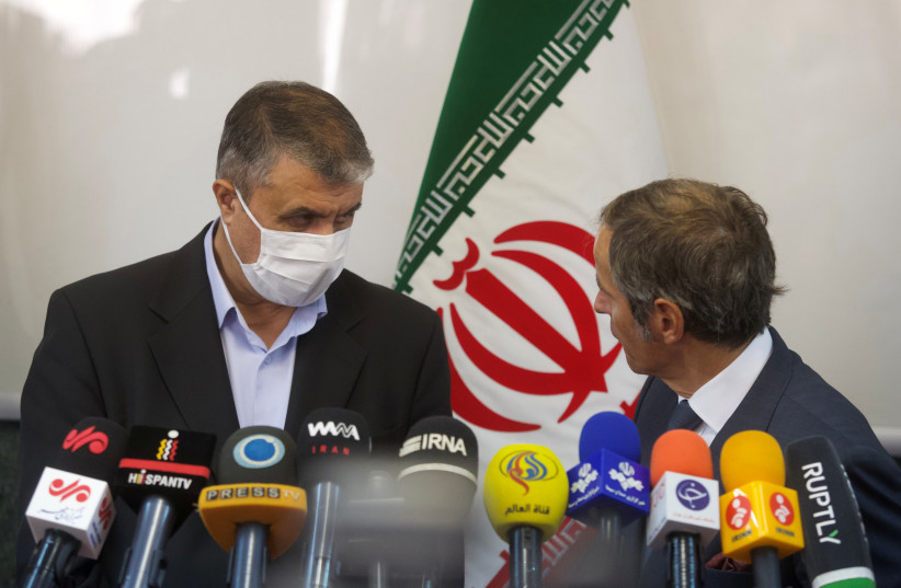 Head of Iran's Atomic Energy Organization Mohammad Eslami and International Atomic Energy Agency (IAEA) Director General Rafael Grossi attend a news conference, in Tehran, Iran, September 12, 2021. (photo credit: WANA (WEST ASIA NEWS AGENCY) VIA REUTERS)
