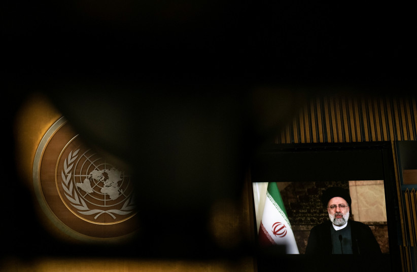 Iran's President's Ebrahim Raisi remotely addresses the 76th Session of the UN General Assembly by pre-recorded video in New York City, US, September 21, 2021. (photo credit: REUTERS/EDUARDO MUNOZ/POOL)