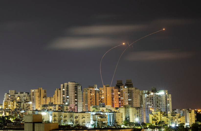 Streaks of light are seen as Israel's Iron Dome anti-missile system intercepts rockets launched from the Gaza Strip towards Israel, as seen from Ashkelon May 20, 2021.  (photo credit: REUTERS/AMIR COHEN/FILE PHOTO)