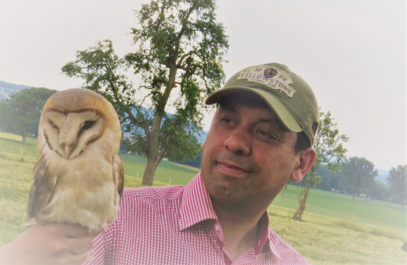 Professor Imad Chirkawi with an owl (credit: Courtesy)
