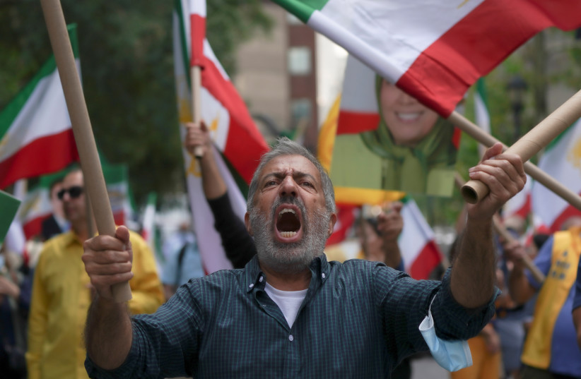 Iranian Americans rally against Ebrahim Raisi outside the United Nations headquarters during the 76th Session of the U.N. General Assembly, in New York, US, September 21, 2021. (credit: REUTERS/DAVID 'DEE' DELGADO)
