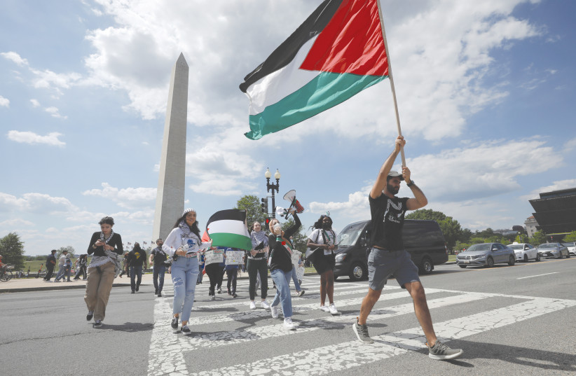 PRO-PALESTINIAN demonstrators protest at the Washington Monument earlier this year. (credit: YURI GRIPAS/REUTERS)