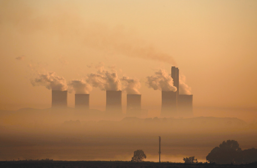 STEAM RISES at sunrise from the coal-fired Lethabo Power Station, owned by state power utility ESKOM near Sasolburg, South Africa. (photo credit: SIPHIWE SIBEKO/REUTERS)