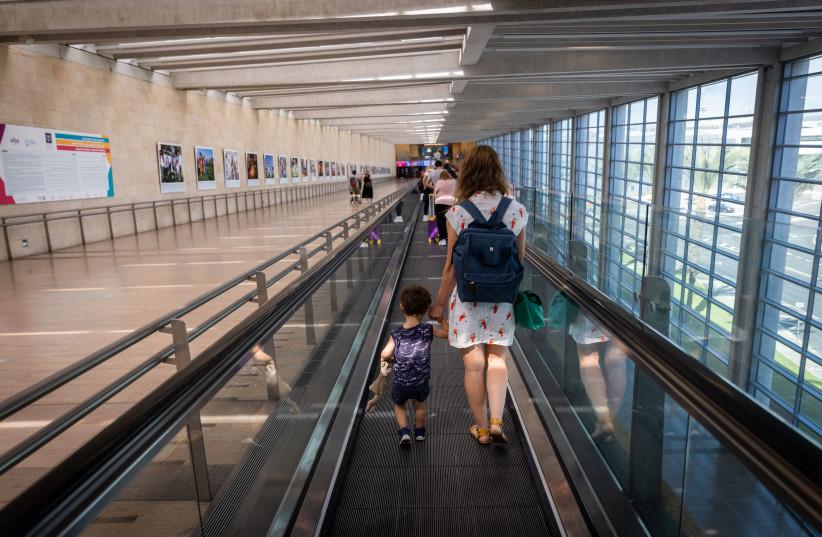 Travelers at the Ben-Gurion Airport near Tel Aviv, September 6, 2021.  (photo credit: YONATAN SINDEL/FLASH90)