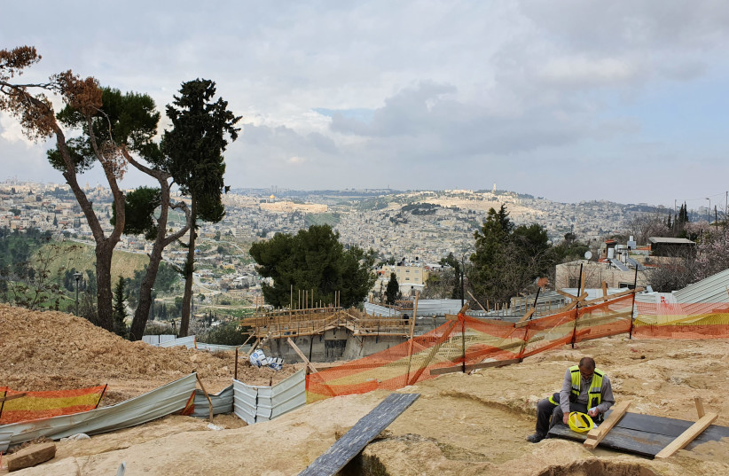 The excavation of the royal estate discovered in Jerusalem. In the background is the City of David and the Temple Mount.  (credit: YOLI SCHWARTZ/IAA)