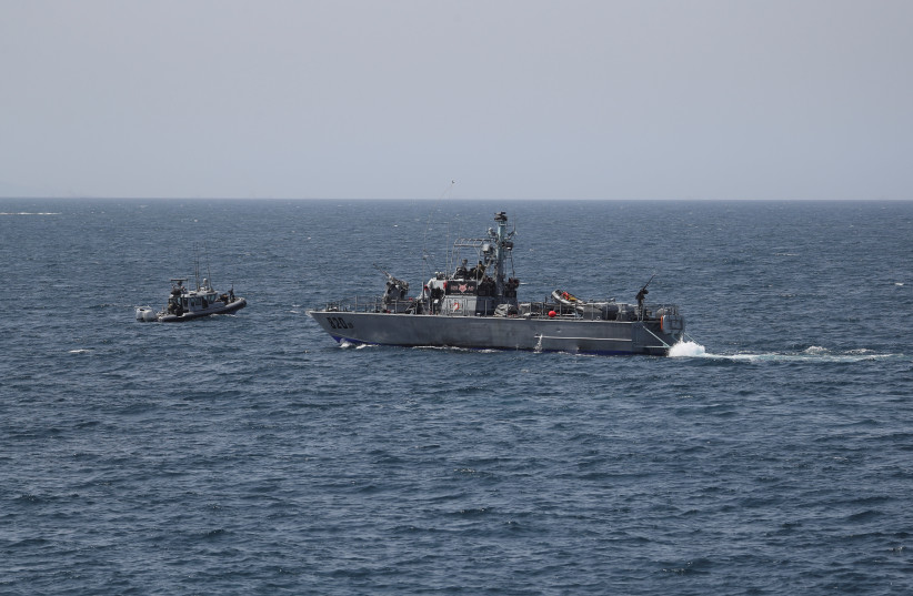 Israeli navy boats are seen in the Mediterranean Sea as seen from Rosh Hanikra, close to the Lebanese border, northern Israel May 4, 2021. (photo credit: REUTERS/AMMAR AWAD)