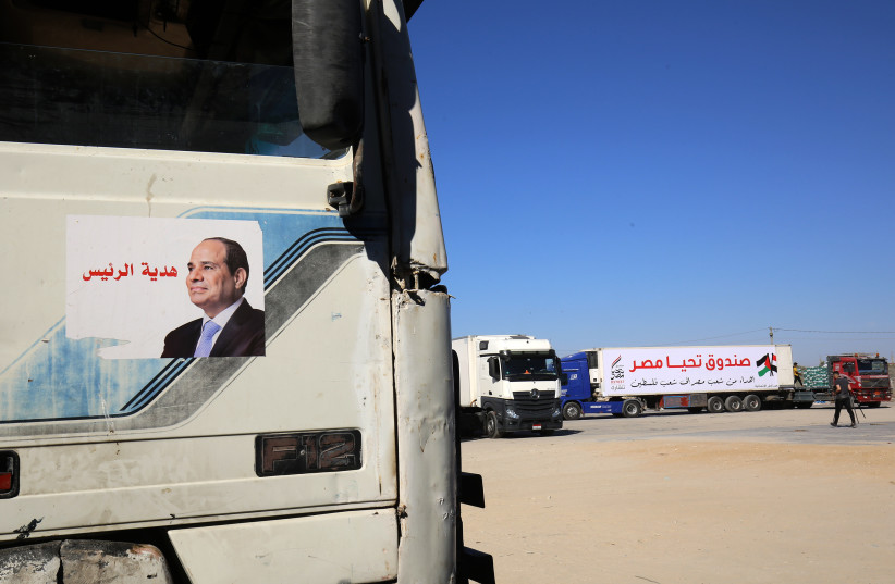 Egyptian trucks loaded with humanitarian aid, arrive from Egypt to the Rafah border crossing, in the southern Gaza Strip (credit: ABED RAHIM KHATIB/FLASH90)