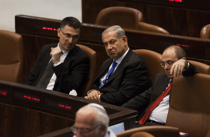SIDE by side with  Benjamin Netanyahu in the  Knesset, 2013.  (credit: FLASH90)