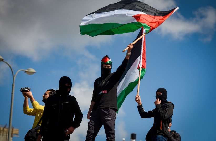 ISRAELI-ARABS protest violence, organized crime and killings among their communities, in Umm al-Fahm, March 5 (credit: RONI OFER/FLASH90)