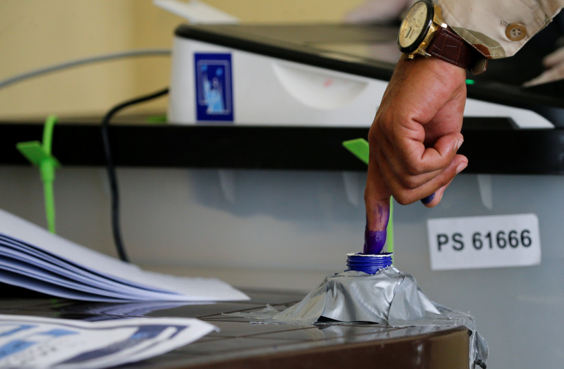 A member of Iraqi Security forces casts his vote, two days before polls open to the public in a parliamentary election, in Mosul, Iraq October 8, 2021. (credit: REUTERS/KHALED AL-MOUSILY)