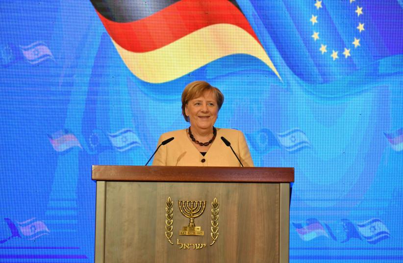 Israeli Prime Minister Naftali Bennett and outgoing German Chancellor Angela Merkel in Jerusalem, October 10, 2021. (credit: YOAV DAVIDKOVITZ / POOL)