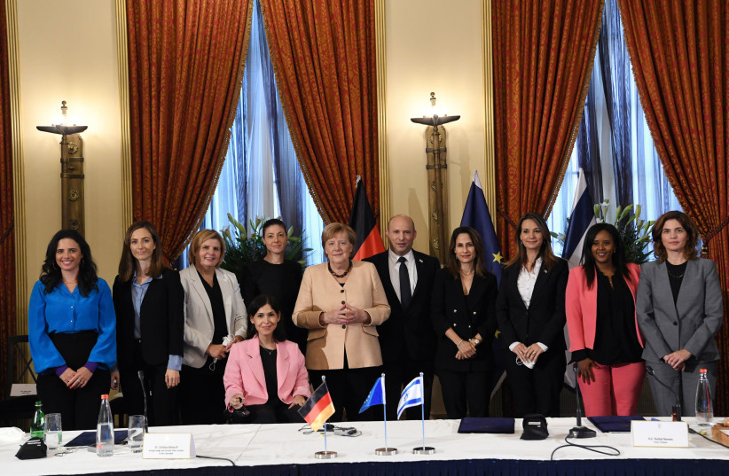 Chancellor Angela Merkel and Prime Minister Naftali Bennett posing with all of Israel's female ministers in the 36th government. (credit: AMOS BEN-GERSHOM/GPO)