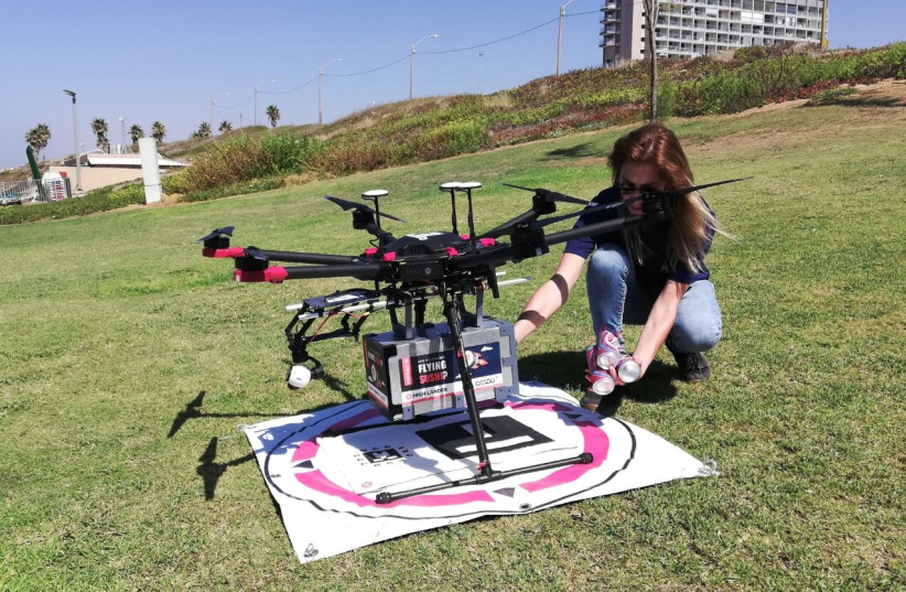 A drone delivers sushi to waiting recipients in the Tel Aviv area, October 11 2021  (photo credit: ZEV STUB)