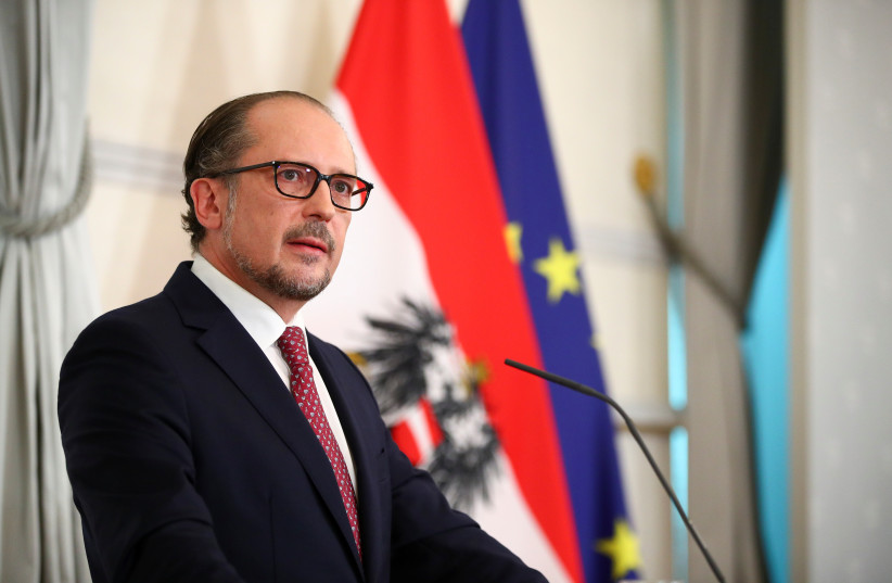 Austria's new Chancellor of the People's Party (OVP) Alexander Schallenberg addresses the media at the Federal Chancellery in Vienna, Austria October 11, 2021. (credit: REUTERS/LISI NIESNER)