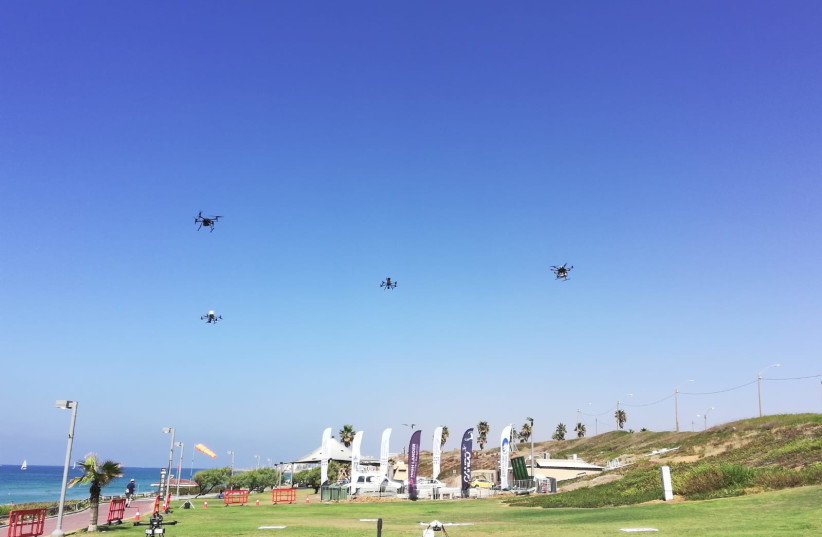 A drone delivers sushi to waiting recipients in the Tel Aviv area, October 11, 2021. (credit: ZEV STUB)