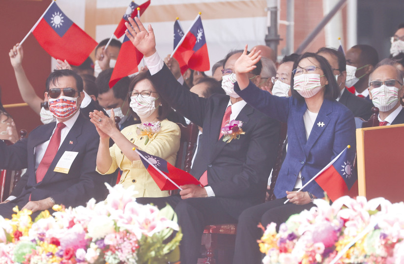TAIWAN'S PRESIDENT Tsai Ing-Wen (second right) attends a National Day celebration in Taipei on Sunday. (photo credit: ANN WANG/REUTERS)