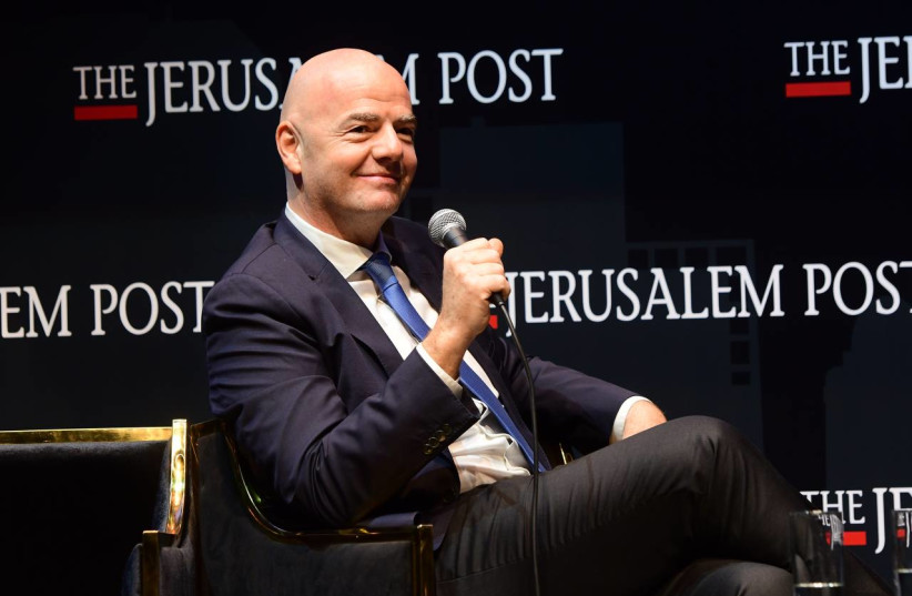 FIFA president Gianni Infantino is seen speaking at the Jerusalem Post annual conference at the Museum of Tolerance in Jerusalem, on October 12, 2021. (credit: AVSHALOM SASSONI/MAARIV)