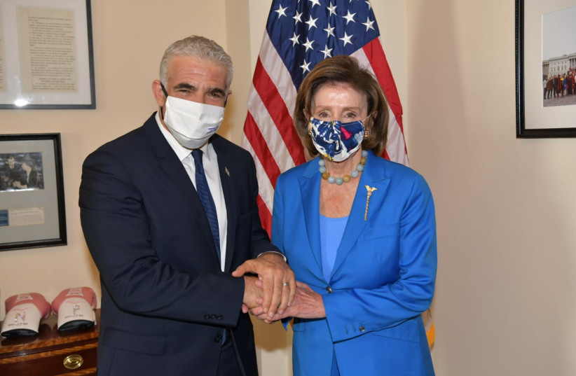 FOREIGN MINISTER Yair Lapid visits US Speaker of the House Nancy Pelosi, October 12, 2021 (photo credit: OZ AVITAL/GOVERNMENT PRESS OFFICE)