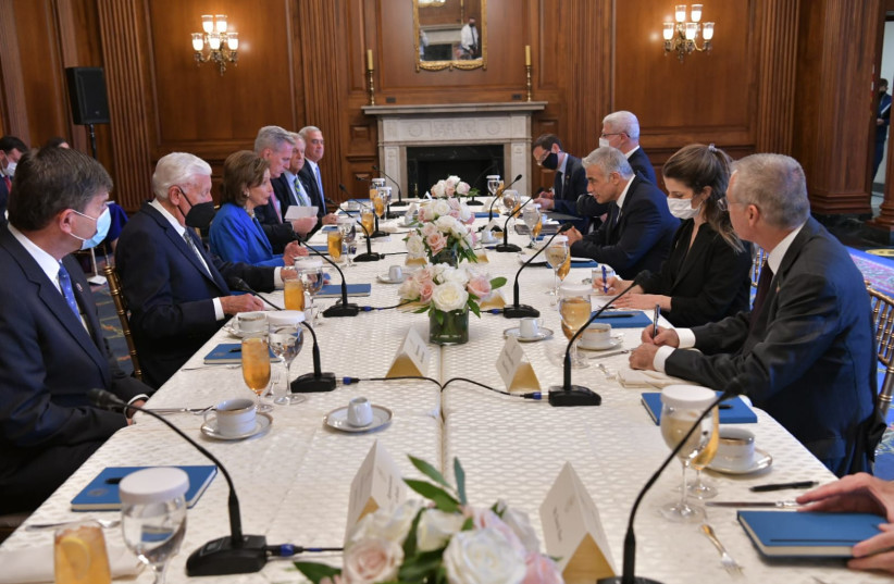 FOREIGN MINISTER Yair Lapid visits US Speaker of the House Nancy Pelosi, October 12, 2021 (credit: OZ AVITAL/GOVERNMENT PRESS OFFICE)