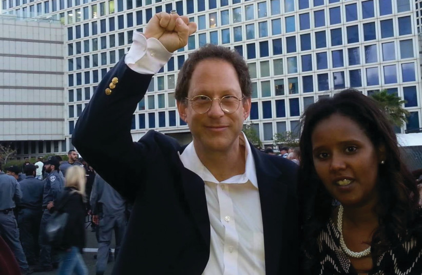 YOSSI ABRAMOWITZ and Pnina Tamano-Shata in their younger years protesting against police violence against members of Israel's Ethiopian community. (credit: Courtesy Yossi Abramowitz)