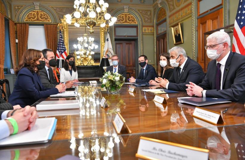 Yair Lapid and Kamala Harris meet in Washington, October 13, 2021. (credit: OZ AVITAL/GOVERNMENT PRESS OFFICE)