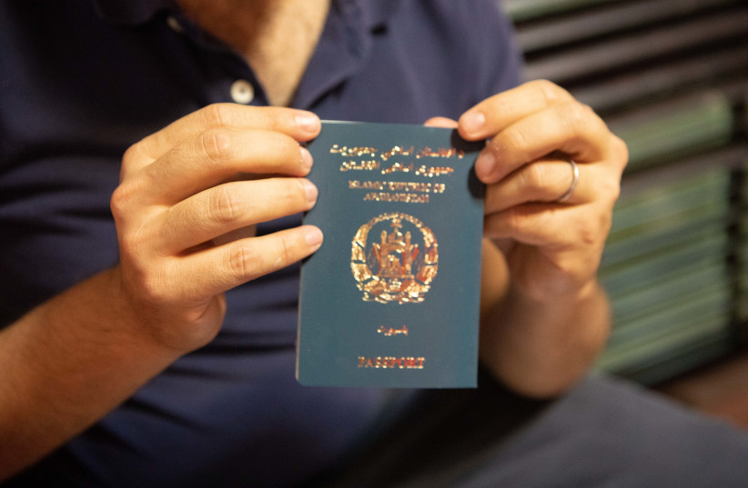 Afghan passport. (photo credit: ETHAN SCHWARTZ (ISRAAID))