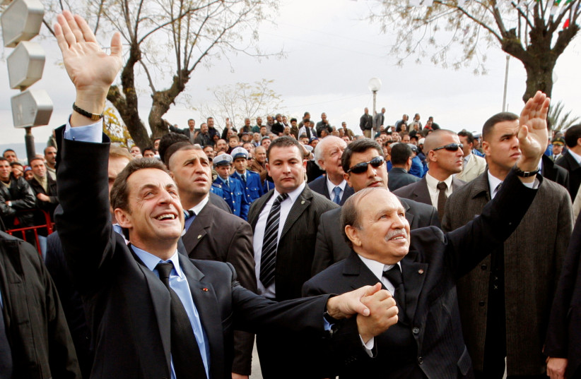 DURING BETTER times, Then-French president Nicolas Sarkozy (left) and Algeria's then-president Abdelaziz Bouteflika wave as they walk in the old city of Constantine on the last day of Sarkozy's three-day official visit in Algeria, in 2007.  (credit: PHILIPPE WOJAZER/REUTERS)