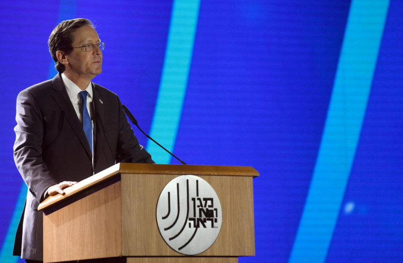 President Isaac Herzog speaks at the ceremony in honor of outgoing leader of the Shin Bet, Nadav Argaman. (credit: CHAIM TZACH/GPO, SHIN BET)