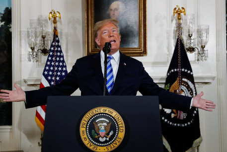 US President Donald Trump announces his intention to withdraw from the JCPOA Iran nuclear agreement during a statement in the Diplomatic Room at the White House in Washington, US, May 8, 2018