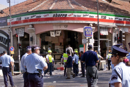 A gaping hole is left in the shop front of the Sbarro pizzeria after a suicide bombing, August 9, 2001