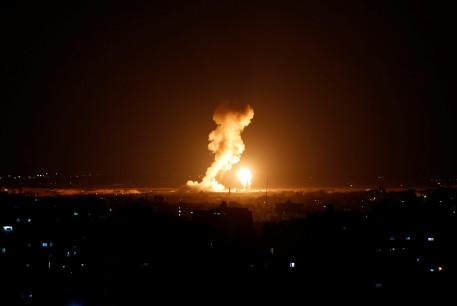 Smoke and flame are seen during an Israeli air strike in Gaza, November 12, 2018