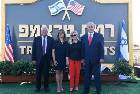US Ambassador to Israel David Friedman [L] his wife Tammy Deborah Sand, Sara Netanyahu, and Prime Minister Benjamin Netanyahu [R] near the sign of Trump Heights in the Golan