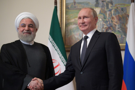 Russian President Vladimir Putin shakes hands with Iranian President Hassan Rouhani during a meeting on the sidelines of a session of the Supreme Eurasian Economic Council In Yerevan, Armenia October 1, 2019