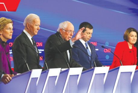 DEMOCRATIC 2020 US presidential candidates (from left) billionaire activist Tom Steyer, Senator Elizabeth Warren, former vice president Joe Biden, Senator Bernie Sanders, former South Bend mayor Pete Buttigieg and Senator Amy Klobuchar participate in the seventh Democratic 2020 presidential debate a