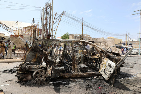 The wreckage of a car is seen at the scene of a bomb explosion at the Maka al-Mukarama street in Mogadishu, Somalia January 8, 2020